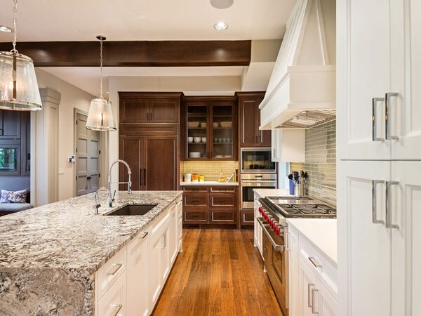 Newly remodeled kitchen with white and brown cabinets