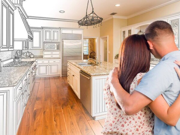 Couple watching their kitchen go from a drawing to real
